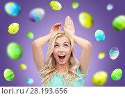 Купить «happy woman making bunny ears over easter eggs», фото № 28193656, снято 13 февраля 2016 г. (c) Syda Productions / Фотобанк Лори
