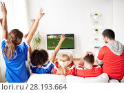 Купить «friends or soccer fans watching game on tv at home», фото № 28193664, снято 14 августа 2016 г. (c) Syda Productions / Фотобанк Лори
