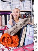 Купить «Young smiling woman client buying multiple items», фото № 28193932, снято 14 августа 2018 г. (c) Яков Филимонов / Фотобанк Лори