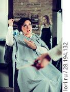 Купить «Angry woman telling to hairdresser that she does not like her hairstyle», фото № 28194132, снято 7 марта 2017 г. (c) Яков Филимонов / Фотобанк Лори