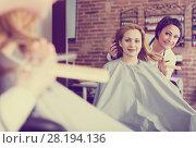 Купить «Woman consults with master in hairdress», фото № 28194136, снято 7 марта 2017 г. (c) Яков Филимонов / Фотобанк Лори