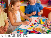 Купить «Plasticine modeling clay in children class. Teacher teaches in school.», фото № 28195172, снято 25 марта 2017 г. (c) Gennadiy Poznyakov / Фотобанк Лори