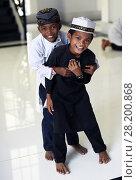 Купить «Two young Cambodian Cham Muslim boy smiling in Kampong Cham mosque, Cambodia, South East Asia, Asia.», фото № 28200868, снято 24 ноября 2017 г. (c) age Fotostock / Фотобанк Лори
