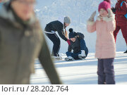 Купить «Girls Teens having fun at winter skate ring», фото № 28202764, снято 8 марта 2018 г. (c) Константин Шишкин / Фотобанк Лори