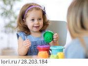 Купить «Kid with teacher in kindergarten», фото № 28203184, снято 19 сентября 2018 г. (c) Оксана Кузьмина / Фотобанк Лори