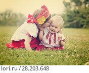 Купить «Two happy children in folk clothes in summer», фото № 28203648, снято 15 июня 2013 г. (c) Яков Филимонов / Фотобанк Лори