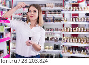 Купить «Woman looking for new color of nail varnish», фото № 28203824, снято 31 января 2018 г. (c) Яков Филимонов / Фотобанк Лори
