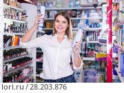 Купить «attractive young woman choosing haircare products at store», фото № 28203876, снято 31 января 2018 г. (c) Яков Филимонов / Фотобанк Лори