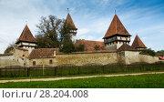 Купить «Church Fortification in Cincsor is landmark of Transilvania», фото № 28204008, снято 17 сентября 2017 г. (c) Яков Филимонов / Фотобанк Лори