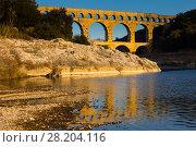 Купить «Pont du Gard, an ancient Roman bridge in southern France», фото № 28204116, снято 8 декабря 2017 г. (c) Яков Филимонов / Фотобанк Лори