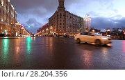 Купить «Christmas and New Year holidays illumination and Traffic of cars in Moscow city center (Tverskaya Street near the Kremlin) at night, Russia», видеоролик № 28204356, снято 19 марта 2018 г. (c) Владимир Журавлев / Фотобанк Лори