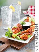 Купить «Hot chicken wings appetizer», фото № 28204624, снято 14 марта 2018 г. (c) Елена Веселова / Фотобанк Лори