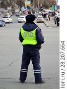 Купить «Kazan, Russia - Mar 27.2017.traffic police inspector is on duty in city street.», фото № 28207664, снято 27 марта 2017 г. (c) Володина Ольга / Фотобанк Лори