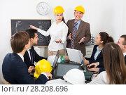 Купить «Group of adult engineers discussing project», фото № 28208696, снято 7 декабря 2019 г. (c) Яков Филимонов / Фотобанк Лори