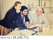 Купить «Employees are demonstrating reports on laptop to mature boss», фото № 28208712, снято 27 июня 2017 г. (c) Яков Филимонов / Фотобанк Лори