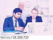 Купить «Employees are demonstrating reports on laptop to mature boss», фото № 28208720, снято 27 июня 2017 г. (c) Яков Филимонов / Фотобанк Лори