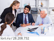 Купить «Office workers are writing financial reports and discussing with mature boss», фото № 28208732, снято 27 июня 2017 г. (c) Яков Филимонов / Фотобанк Лори
