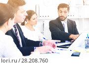 Купить «Businessman with partners in office», фото № 28208760, снято 12 ноября 2019 г. (c) Яков Филимонов / Фотобанк Лори