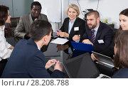 Купить «business partners discussing projects and ideas at meeting», фото № 28208788, снято 12 февраля 2018 г. (c) Яков Филимонов / Фотобанк Лори
