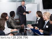 Купить «Male speaker giving talk on corporate business meeting», фото № 28208796, снято 12 февраля 2018 г. (c) Яков Филимонов / Фотобанк Лори