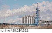 Купить «Tanks and smoking pipes of a large industrial power plant», фото № 28210332, снято 20 апреля 2018 г. (c) Константин Шишкин / Фотобанк Лори