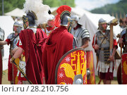 Купить «MOSCOW - JUN 06, 2015: Roman soldiers at the festival Times and epoch: Ancient Rome in Kolomenskoye», фото № 28210756, снято 6 июня 2015 г. (c) Losevsky Pavel / Фотобанк Лори