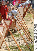 Купить «MOSCOW - JUN 06, 2015: The row of shields and spears of soldiers in the Roman military camp at the festival Times and epoch: Ancient Rome in Kolomenskoye», фото № 28210768, снято 6 июня 2015 г. (c) Losevsky Pavel / Фотобанк Лори