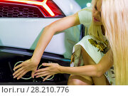 Купить «Young woman in flowery dress closes exhaust pipes of car with her hands», фото № 28210776, снято 2 июня 2016 г. (c) Losevsky Pavel / Фотобанк Лори