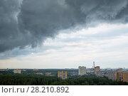 Купить «Grey rainy clouds move to city», фото № 28210892, снято 4 июня 2016 г. (c) Losevsky Pavel / Фотобанк Лори
