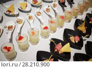 Купить «Rows of snacks and drinks on banquet table in restaurant», фото № 28210900, снято 6 июня 2016 г. (c) Losevsky Pavel / Фотобанк Лори