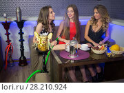Купить «Three young sexy women have fun in the smoky room», фото № 28210924, снято 22 апреля 2015 г. (c) Losevsky Pavel / Фотобанк Лори