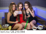 Купить «Three young sexy girl make selfie resting in the smoky room, focus on the right girl», фото № 28210944, снято 22 апреля 2015 г. (c) Losevsky Pavel / Фотобанк Лори
