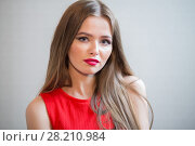 Купить «Beautiful young girl with long hair in red dress», фото № 28210984, снято 22 апреля 2015 г. (c) Losevsky Pavel / Фотобанк Лори