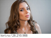 Купить «Beautiful young woman with curly hair and pendant on neck», фото № 28210988, снято 22 апреля 2015 г. (c) Losevsky Pavel / Фотобанк Лори