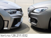 Купить «MOSCOW - JUN 19, 2016: Two sport model car BMW gray colored standing opposite each other», фото № 28211032, снято 19 июня 2016 г. (c) Losevsky Pavel / Фотобанк Лори