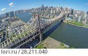 Купить «Queensboro Bridge at summer sunny day in New-York City. Aerial view», фото № 28211040, снято 26 июня 2019 г. (c) Losevsky Pavel / Фотобанк Лори