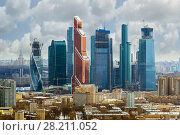 Купить «MOSCOW, RUSSIA - APR 1, 2014: Modern skyscrapers of Moscow City business complex. Moscow City include area of business activity. I have only one version of the photo with sharpening», фото № 28211052, снято 1 апреля 2014 г. (c) Losevsky Pavel / Фотобанк Лори