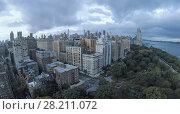 Купить «Residential houses near crossroad of Riverside Drive with West 79th street at summer evening. Aerial view», фото № 28211072, снято 20 июля 2018 г. (c) Losevsky Pavel / Фотобанк Лори