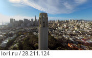 Купить «SAN FRANCISCO - NOV 23, 2014: Coit Tower and cityscape at sunny day. Aerial view. Coit Tower was built in 1933.», фото № 28211124, снято 23 ноября 2014 г. (c) Losevsky Pavel / Фотобанк Лори