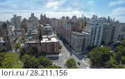 Купить «Cars ride by crossroad of Riverside Drive and West 79th street at summer day. Aerial view», фото № 28211156, снято 20 июля 2018 г. (c) Losevsky Pavel / Фотобанк Лори