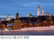 Купить «Bell tower of Ivan Great, Kremlin wall and Cathedral of Christ Saviour at evening in Moscow», фото № 28211568, снято 15 января 2015 г. (c) Losevsky Pavel / Фотобанк Лори