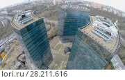 Купить «MOSCOW - APR 21, 2015: Business complex Lotos at spring cloudy day. Aerial view video frame», фото № 28211616, снято 21 апреля 2015 г. (c) Losevsky Pavel / Фотобанк Лори