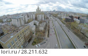 Купить «MOSCOW - APR 22, 2015: Cityscape with transport traffic on quay of Yauza river at spring cloudy day. Aerial view video frame», фото № 28211632, снято 22 апреля 2015 г. (c) Losevsky Pavel / Фотобанк Лори