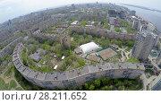 Купить «Urban sector on shore of Volga river at spring sunny day. Aerial view video frame», фото № 28211652, снято 21 августа 2019 г. (c) Losevsky Pavel / Фотобанк Лори