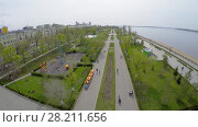 Купить «SAMARA - MAY 05, 2015: Public garden on quay of Volga river at spring sunny day. Aerial view video frame», фото № 28211656, снято 5 мая 2015 г. (c) Losevsky Pavel / Фотобанк Лори