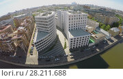 Купить «MOSCOW - MAY 20, 2015: Cityscape with business complex Aquamarine on quay with cars at spring sunny day. Aerial view», фото № 28211688, снято 20 мая 2015 г. (c) Losevsky Pavel / Фотобанк Лори