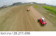 Купить «SAMARA - MAY 24, 2015: Three small racing cars ride by ground track at spring sunny day. Aerial view video frame», фото № 28211696, снято 24 мая 2015 г. (c) Losevsky Pavel / Фотобанк Лори