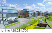 Купить «MOSCOW - JUN 03, 2015: People walk near modern buildings of Business Center Olympia-Park at summer sunny day. Aerial view videoframe», фото № 28211700, снято 3 июня 2015 г. (c) Losevsky Pavel / Фотобанк Лори