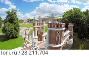 Купить «MOSCOW - JUN 06, 2015: Historical complex with Catherines Palace in Ttsaritsyno at summer day. Aerial view», фото № 28211704, снято 6 июня 2015 г. (c) Losevsky Pavel / Фотобанк Лори