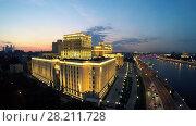 Купить «MOSCOW - JUN 24, 2015: Edifice National Control Center of Russian Federation Defense at summer evening. Aerial view», фото № 28211728, снято 24 июня 2015 г. (c) Losevsky Pavel / Фотобанк Лори